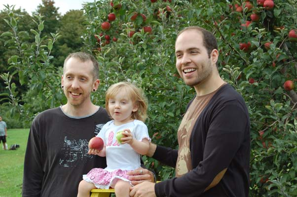 Miss Jilly apple-picking with the daddies, Drew (left) and Jason.