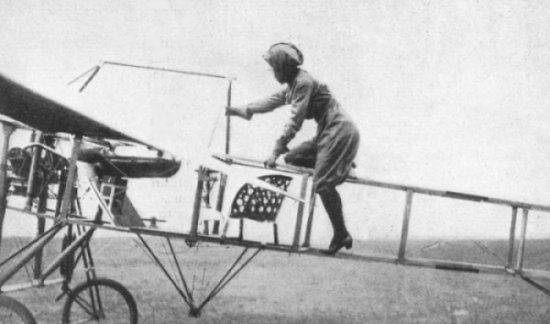 Harriet Quimbly climbs into her Moisant monoplane, wearing her trademark satin flying suit.