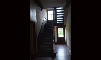It's the little things: The stairs leading to the billiard room are backed in glass to allow light to stream into an otherwise shadowed hallway.