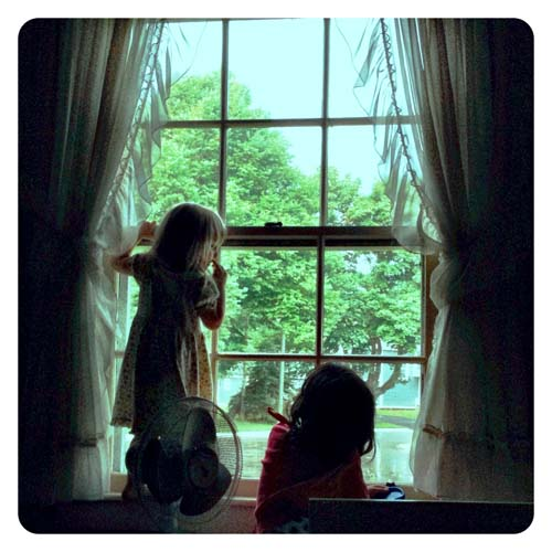 In a rare peaceful moment, the girls watched a thunderstorm together.