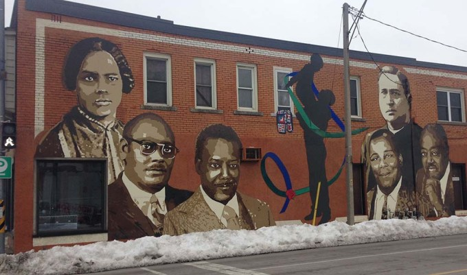 Mural in Windsor, Ont., features Mary Ann Shadd, Bishop C.L. Morton, Justin Jackson, Rev. J.T. Wagner, Walter Perry and Alton C. Parker. There is also an Underground Railroad quilt pattern and a Harmony Ribbon, the symbol of Windsors.