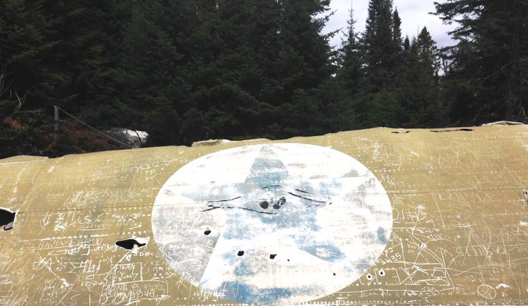 A wing of the Liberator B-24 that crashed near St. Donat in 1943 still bears the American star — it was new enough that the Canadians hadn't had time to repaint it.