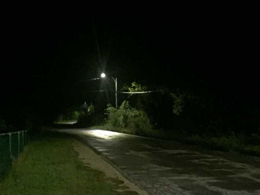 barren dark night road streetlight