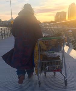 A homeless man crosses the Johnson Street Bridge in Victoria, B.C.